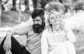 Couple Bearded Man And Woman Enjoy Nature While Sit On Green Grass Meadow. Nature Beauty Concept. Wo poster