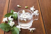 White Flowers Jasmine Flora Local Of Asia Float On Water In Glass Arrangement Flat Lay Style On Tabl poster