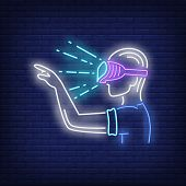 Guy Wearing Vr Goggles Neon Sign. Man In Vr Glasses Pointing Finger On Brick Wall Background. Vector poster