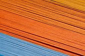 Colored paper strips as a colorful backdrop. The colored paper on a background. poster
