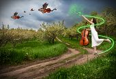 stock photo of woman dragon  - Woman in white dress making magic with her commissure wand and dragon violins with bat wings flying away in the sky - JPG