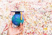Education World Study Abroad Educational Knowledge Idea. Graduation Cap On Businessman Holding Paper poster