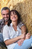 image of concubine  - couple of farmers all smiles posing in barn - JPG