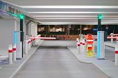 Barrier At Entrance And Exit Of A Car Parking Garage. Barrier In A Car Park. Exit From Underground P poster