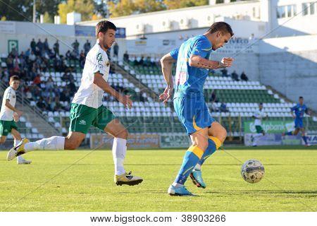 KAPOSVAR, HUNGARY - OCTOBER 20: Unidentified players in action at a Hungarian National Championship soccer game - Kaposvar (white) vs Siofok (blue) on October 20, 2012 in Kaposvar, Hungary.