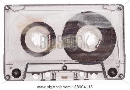 Old broken cassette isolated on white