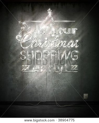 Do your Christmas shopping early, neon sign over old wall. Vector Illustration.