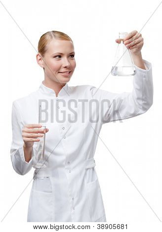 Lady doctor hands measuring glass and Erlenmeyer flask, isolated on white