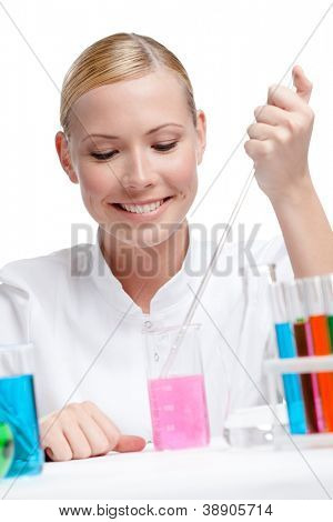 Female lab assistant is surrounded by medical vials and flasks, isolated on white