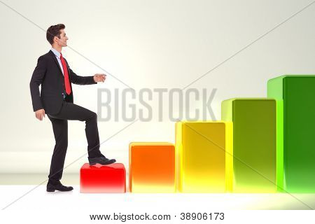 side view of a young smiling business man stepping forward on a growing graph