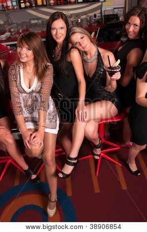 Girls company having fun in the night club