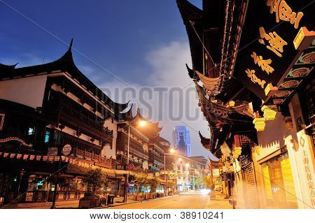 SHANGHAI, CHINA - MAY 30: Chenghuangmiao street at night with pagoda style buildings on May 30, 2012 in Shanghai. It is the largest city by population in the world with 23 million in 2010