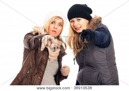 Women In Winter Clothes Pointing At You
