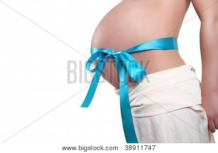 Belly With Blue Ribbon Bow Of Pregnant Woman, Isolated Over White Background.