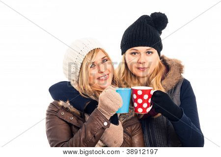 Two Women In Winter Clothes Holding Mug
