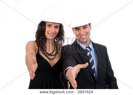 Young Business Couple Offering To Shake Hands