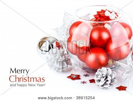christmas red ball with festive tinsel isolated on white background