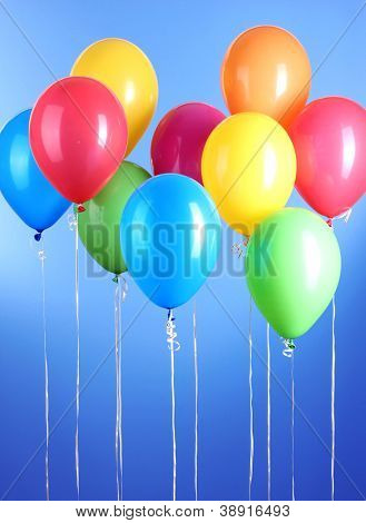 Colorful balloons on blue background