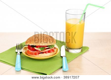 Appetizing sandwich on color plate on wooden table on white background