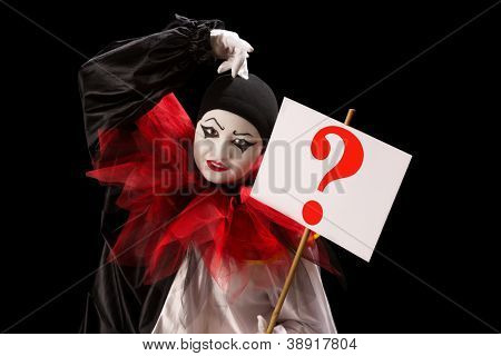 Young Pierrot holding a sign with a question mark