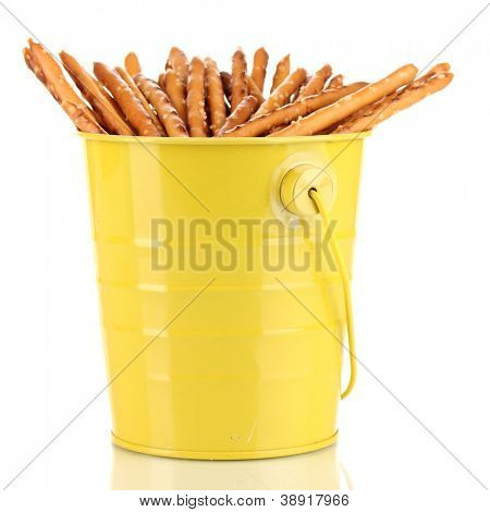 Tasty crispy sticks in yellow pail isolated on white