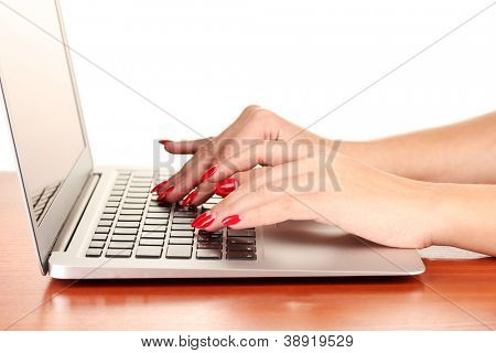 Detail of female hands using  computer isolated on white