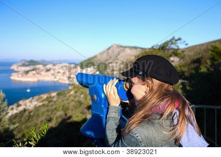 Tourist using telescope, Dubrovnik old town, Croatia