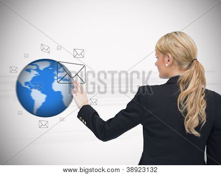 Message symbols floating around a globe with woman selecting one