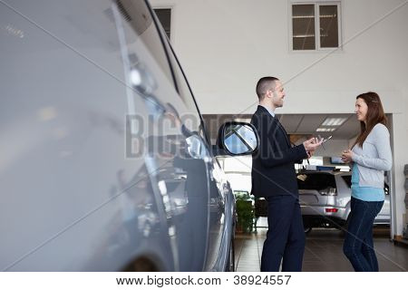 Salesman speaking with a client in a garage