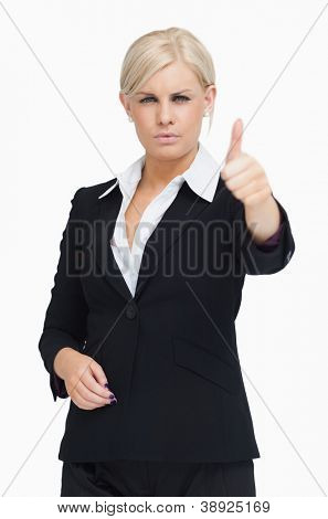 Serious blond businesswoman thumb-up against white background