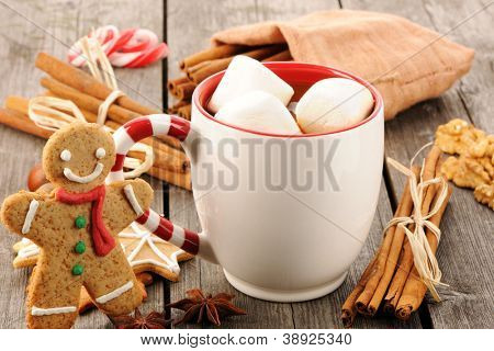 Mug of hot chocolate on wooden table