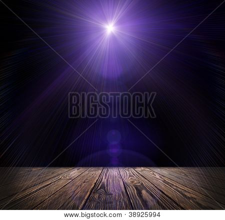 Spot lighting over dark background and wood floor. concert