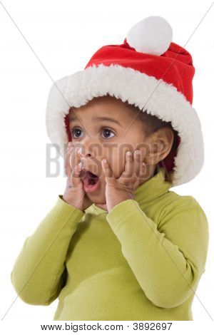 Surprised Baby Girl With Red Hat Of Christmas