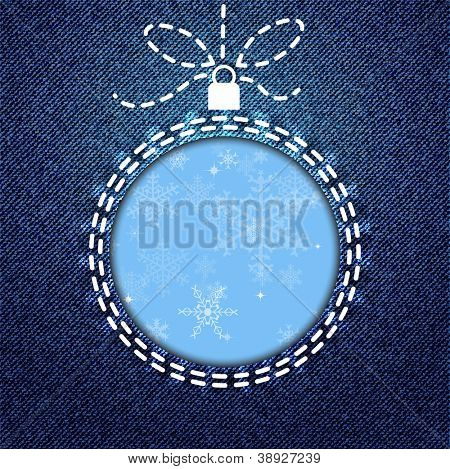 A cutout of a Christmas bauble on denim background with snowflake pattern. Also available in vector format.