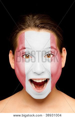 portrait of girl with peruvian flag painted on her face
