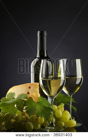 white wine and cheese on black