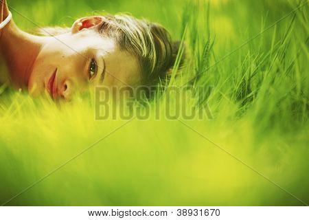 woman sleep on green grass