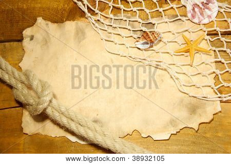 old paper, fishing net and rope on wooden table