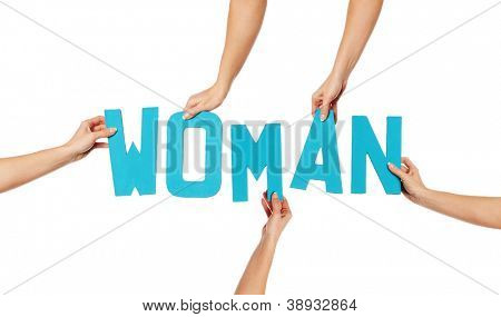 Turquoise blue alphabet lettering spelling WOMAN held up over a white background by female hands