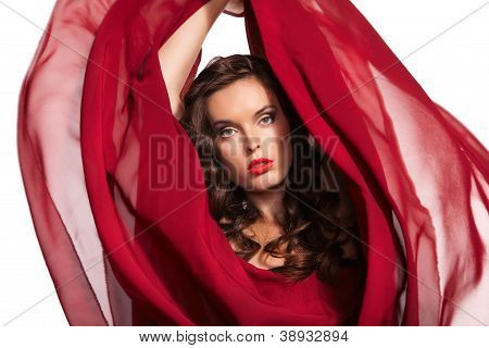 woman in red dress flying on wind. Close-up