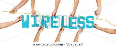 Turquoise blue alphabet lettering spelling WIRELESS with scissors cutting a cord held up over a white background by female hands