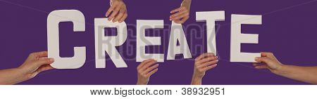 White alphabet lettering spelling CREATE held up over a purple studio background by outstreched female hands