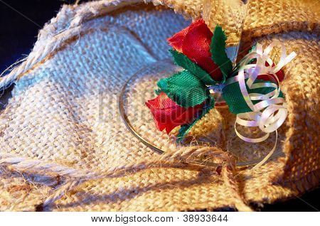 Artificial Flowers Against  The Background Of Baggy Fabric
