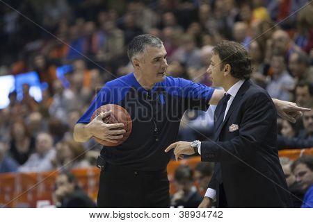 VALENCIA - NOVEMBER 6: Referee (L) and Orhun Ene during Eurocup Bakestball match between Valencia Basket Club and Banvit BK Bandirma, on November 6, 2012, in La Fonteta Stadium, Valencia, Spain