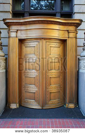 Large curved brass closed doors on a bank entrance