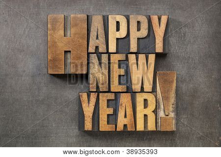 Happy New Year! - text in vintage letterpress wood type blocks on a grunge metal background