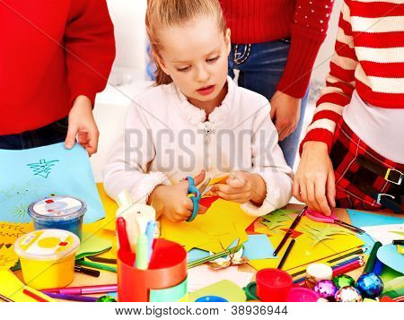 Children making greeting card. Isolated on white.
