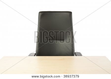 Empty top of the table and leather office chair.