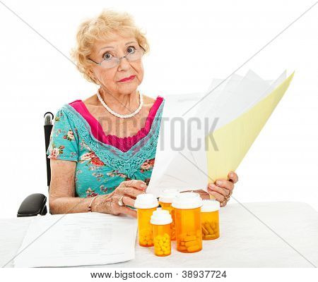 Disabled senior woman, unhappy about mounting medical expenses.  White background.