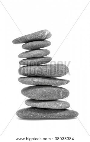 a stack of balanced zen stones on a white background
